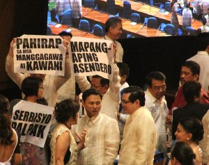 Placards raised by the Makabayan bloc after Aquino's SONA. Photo by Boy Bagwis