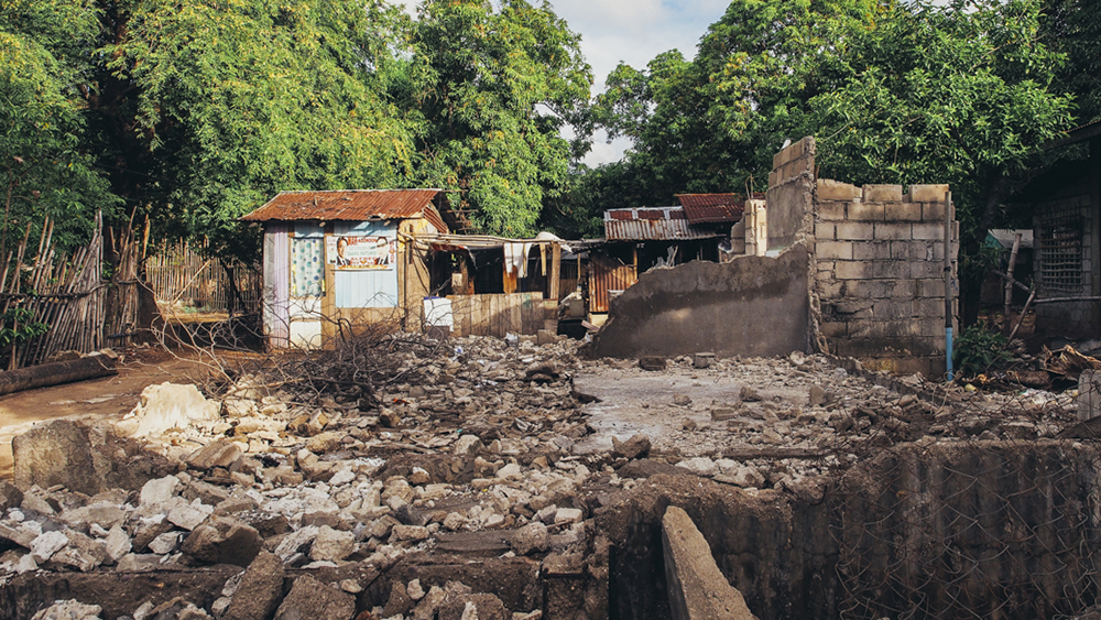 One of the houses demolished in Brgy. Sta Mercedes, Maragondon, Cavite. Each household are paid P5,000 to move out of the community and transfer to the relocation site constructed by M.T.V. Corporation for the residents. Photo by Selina Gabriel.