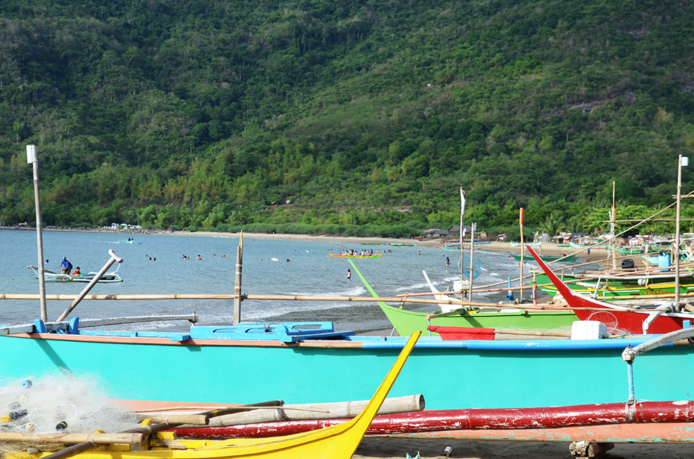 Local tourists frequent Patungan Cove, every summer and on weekends. Local families maximize the opportunity to earn extra for their living from rentals of cottages, selling fish to the tourists and collecting boat fares to and from Patungan Cove and the National Tourism Road. Photo by Jen Guste.