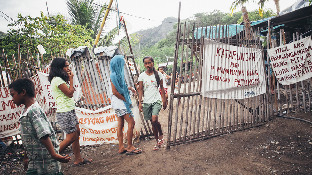 The entrance to the main campsite in Patungan, one of the four campsites the community put up to guard from impending threat and harassment by the police, military and security guards of the M.T.V. Corporation and MSDC of Henry Sy. Photo by Selina Gabriel.