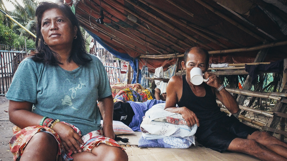 Nanay Suzy Agner and her husband Tatay Burog, who are leaders of Save Patungan Now share their community's struggle as they guard the main campsite in Bgy Sta Mercedes, Maragondon, Cavite. Photo by Selina Gabriel.