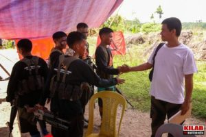 A prisoner of war is released by the New People's Army in Compostela Valley. Photo by Kilab